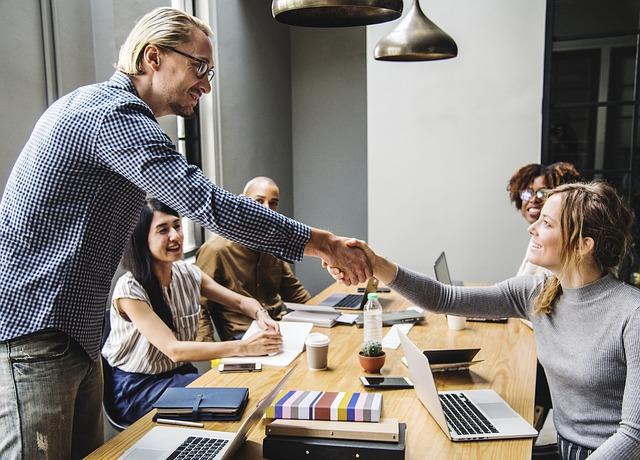 Employees agreeing during meeting